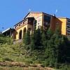 Ritinteggiatura facciata presso  Rifugio Alpette M.lm 2300 Sestriere  con  Pittura acrilsilossanica Acrysil liscia  del Colorificio San Marco
